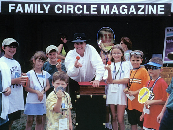 Magician Chaz Misenheimer entertains at a Family Circle Cup event